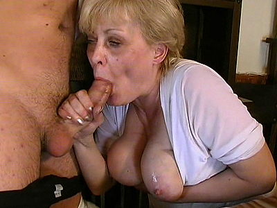 this crazy old mom plays with a young stud s cock licking it and